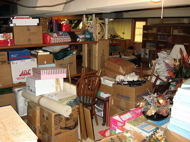 this cluttered basement is in need of a dumpster rental