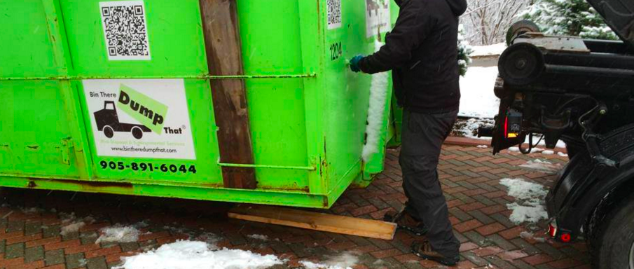 protective boardsrest on the driveway and reduce the chance of a dumpster rental from sliding