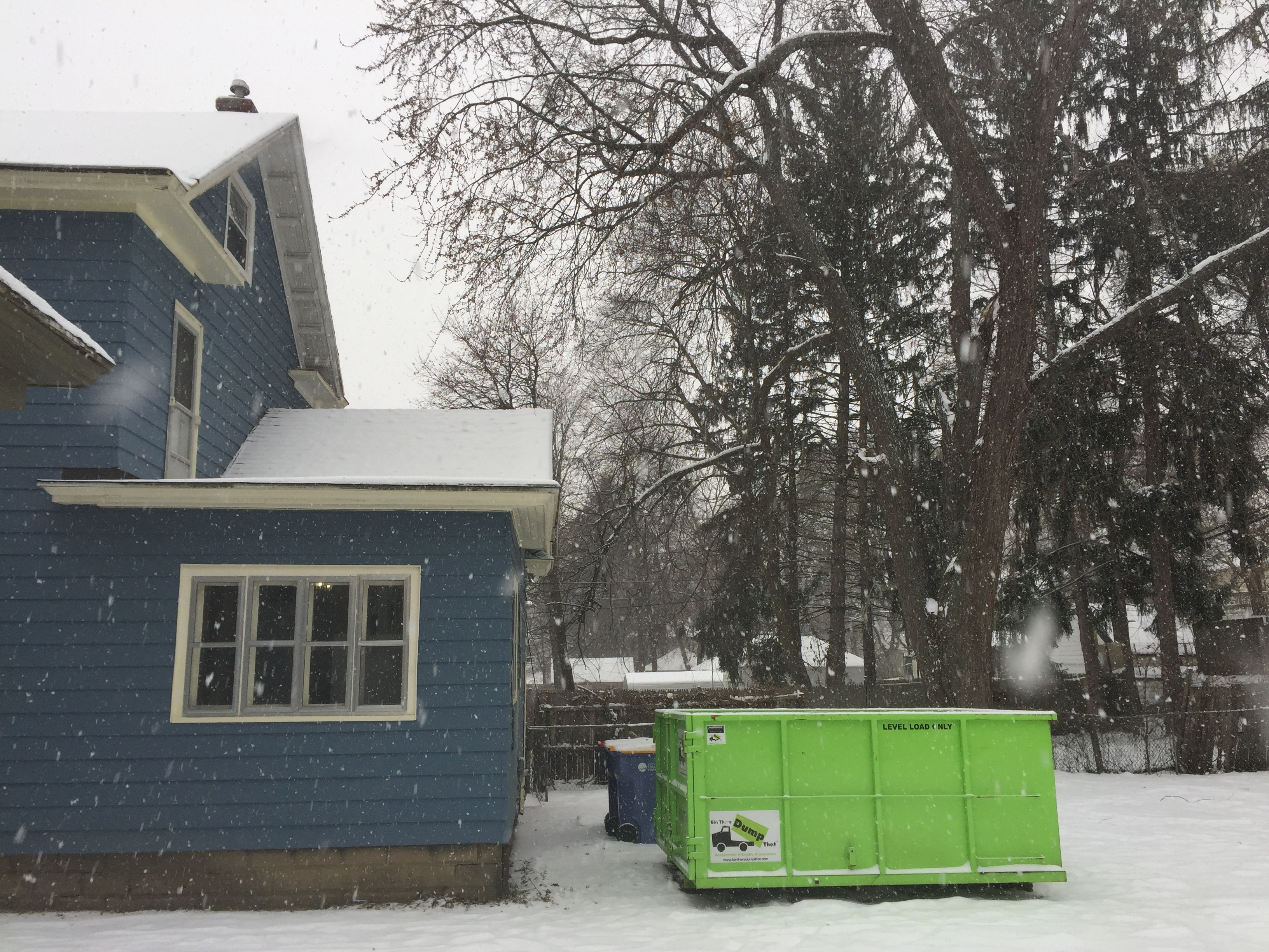 Dumpster Rental Tight Against House