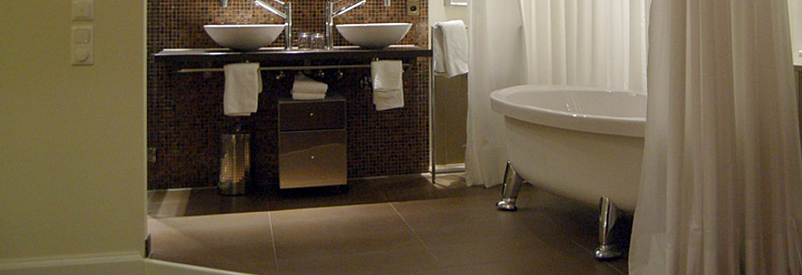 Marble tiles, a big claw foot soaking tub, warming drawers and real furniture pieces make up this spa-like bathroom trend.